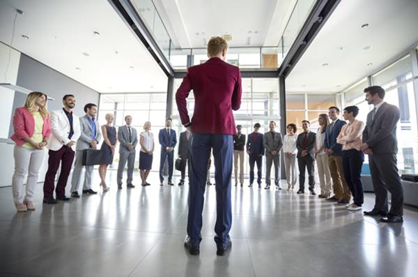 What is the difference between a leader and a manager?